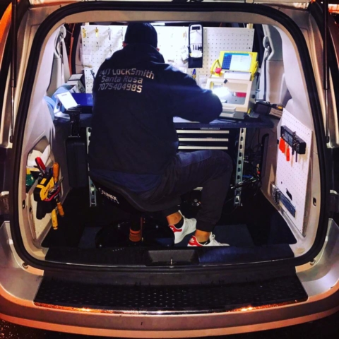 Master Locksmith Employee at Work in the Van