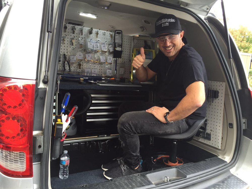 Master Locksmith Employee at Work in Van